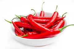 moist red peppers in a bowl - stock photo