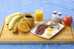 image of breakfast on wooden plank - stock photo