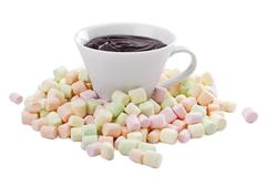 pile of colorful marshmallow and cup of melted chocolate - stock photo