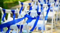 wedding decor. white wooden chairs decorated with blue and white ribbons - stock footage