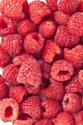 sweet raspberries on a white background - stock photo