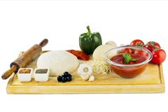 complete set of ingredients for home made pizza - stock photo