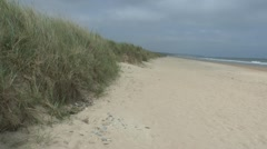 View west along Omaha Beach, Colleville-sur-Mer, Normandy, France. Stock Footage