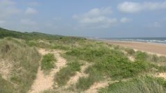 Stock Video Footage of View west along sand dunes above Omaha Beach, Normandy, France.