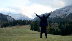 Business man feeling the freedom of the mountains Stock Footage