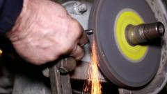 Filing a Piece of Iron with a Rotating Filing Machine Stock Footage
