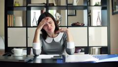 Young, pretty businesswoman having headache during work at home  HD Stock Footage