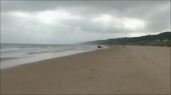 View east along Omaha Beach near Colleville-sur-Mer, Normandy, France. Stock Footage