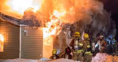 Blazing fire damages house - stock photo