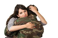 Young woman and soldier in military uniform say goodbye deployment Stock Photos
