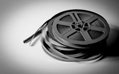 pile of 8mm super8 movie reels in black and white - stock photo