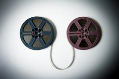 8mm movie reels connected with film in  color effect - stock photo