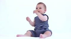 Happy baby boy is laughing and clapping with hands on a white background Stock Footage