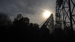 Rollercoaster silhouette going down hill Stock Footage