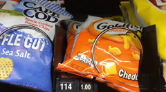 Buying chip snack from vending machine Stock Footage