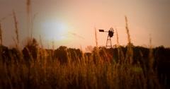Windmill seen through wheat field 4k Stock Footage
