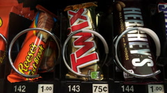 Buying Twix from Snack machine - stock footage