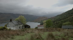 Scottish Highlands, Doune, with cabins, loch, mountains Stock Footage