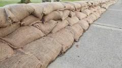 Flood Protection Sandbag Wall dolly shot Stock Footage