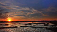 Time lapse of sunset across a swamp Stock Footage