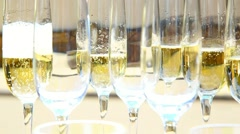 Waitrees pouring champagne into wineglasses. festive drinks. holiday celebration Stock Footage
