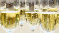 macro of glasses with champagne full of bubbles. holiday party. - stock footage