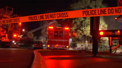 Firetruck flashing lights and police tape at night fire emergency. Stock Footage