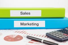 sales and marketing documents with reports - stock photo