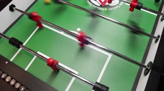 Foosball Table soccer passing and shooting the ball Stock Footage