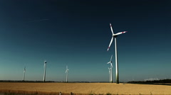 Austrian field and wind turbines Stock Footage