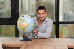 happy man with his global - stock photo