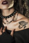 rocker girl portrait with necklace and tattoo - stock photo