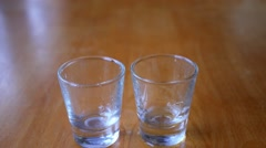 Close-up of Vodka Poured into a Shot Glass Stock Footage