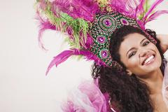 samba dancer wearing pink costume and smiling - stock photo