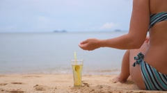Young Woman in Bikini with Cold Drink Beverage at Beach. Arkistovideo