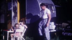 1523 - family camping in the trailer - vintage film home movie - stock footage