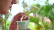 Stock Video Footage of Close-up of Young Woman Eating Yogurt