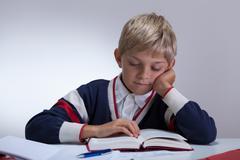 Schoolchild writing book Stock Photos