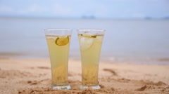 Fresh Drink on Beautiful Beach and Tropical Sea. Slow Motion. Stock Footage