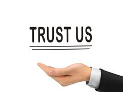 Trust us words holding by realistic hand Stock Illustration