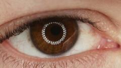 Extreme macro close up eye iris pupil contracting eye light reflection. Stock Footage