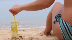 Torso of Sexy Woman with Fresh Drink on Beach. Back View. - stock footage