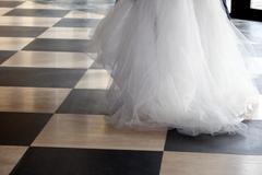 bride over chequered floor - stock photo