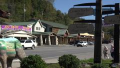 traffic drives along main street, cherokee village, nc, usa - stock footage