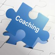 coaching word on blue puzzle pieces - stock illustration