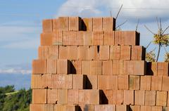 Stack of red bricks, bricks used for building construction - stock photo