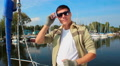 Young handsome yacht owner, confident businessman, portrait HD Footage