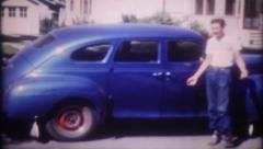 1526 - tall teenager shows off his new car - vintage film home movie Stock Footage