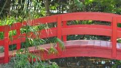 Oriental Garden with red bridge Stock Footage
