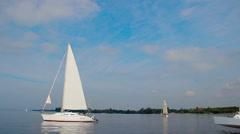 Trimaran sailing yachts in open sea, outdoor activities, sports Stock Footage
